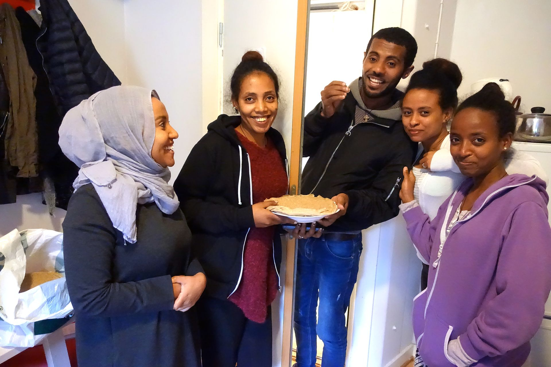 SOLD MENS: Yared Russom sticks his head to the women and says he's hungry. Leila Khaled (fv), Tsega Kidane, Winta Andebrhna and Semhar Hagos give him Eritrean bread.