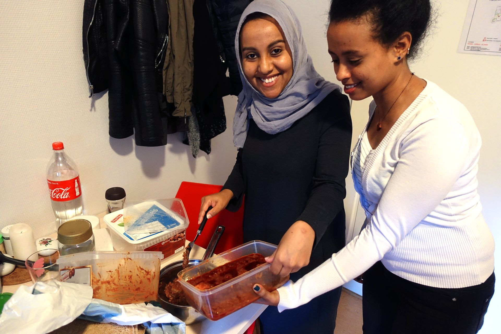 A DAY OF MEAT: Leila Khaled (TV) and Winta Andebrhna are from Eritrea and share rooms at Ila integration reception. Leila has got lamb meat from relatives in the city whom they share for dinner.